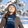 Beautiful young red-haired woman in winter park — Stock Photo #4809580
