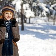 Beautiful young red-haired woman in winter park — Stock Photo #4809599