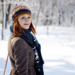Beautiful young red-haired woman in winter park — Stock Photo #4809601