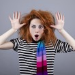 Angry girl with funny hair. — Stock Photo