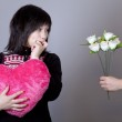 Funny girl with heart and flowers. — Stock Photo