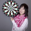 Stock Photo: Girl with darts.