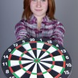 Red-ahired girl with darts. — Stock Photo