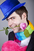 Mystiska män med leksak och rose — Stockfoto