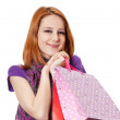 Shopping girl in violet with bag — Stock Photo