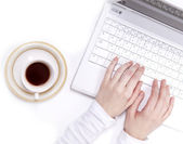Arabian cup of coffe and businesswomen's hand with laptop. — Stock Photo
