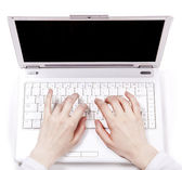 Human hands over laptop keypad during typing. — Stock Photo