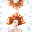 Beatiful red-haired girl with tulips in hair underwater. — Stock Photo