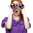 Teen red-haired girl with binoculars isolated on white backgroun — Stock Photo #5169207