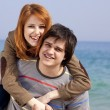 Stock Photo: Portrait of a happy young couple having fun on the beach.