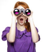 Teen red-haired girl with binoculars isolated on white backgroun — Stok fotoğraf