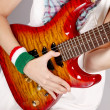 Girl with modern rock guitar — Stock Photo