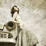 Girl near retro car. — Stock Photo