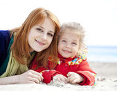 Two sisters at the beach in spring day. — Stock Photo