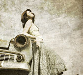Girl near retro car. — Stock Photo