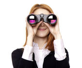 Business women seeking with binocular — Stock Photo