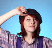 Beautiful girl keep hands near cap and smiling — Stock Photo