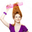 Funny red-haired girl with big comb. — Stock Photo