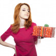 Girl in red with present box. — Stock Photo