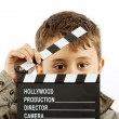 Boy with movie clapper board - Stockfoto