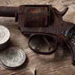Royalty-Free Stock Photo: Revolver and mexican coins