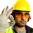 Worker checking vertical level - Stock Photo