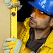 Worker checking vertical level — Stock Photo #4633937