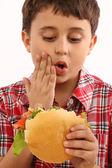 Boy eating hamburger — Stock Photo