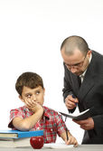 Schoolboy and teacher — Stock Photo