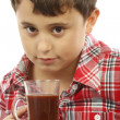 Boy  drinking hot chocolate - Stock Photo