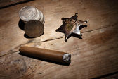 Cigar, badge and coins — Stock Photo