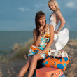 Beautiful girls on beach — Stok Fotoğraf #5110368