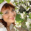 Stock Photo: Flowering apple tree and girl