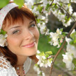 Flowering apple tree and girl — Stock Photo
