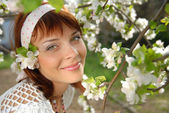 Flowering apple tree and girl — Stock Photo