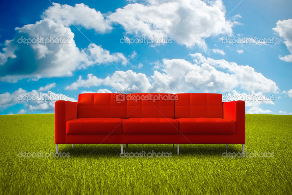 Comfortable red sofa in a green grass meadow — Stock Photo #4023541