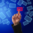 Finger pushing a virtual button on a touch screen — Stockfoto