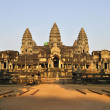 Temple of Angkor Vat in rising sun beams. — Stock Photo