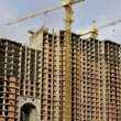 The tower crane on building of a new high-rise apartment house. — Stock Photo #5111112