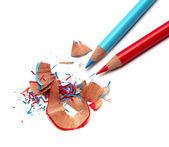 Color pencils and sharpener shaving — Stock Photo