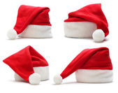 Red santa claus hat on white background — Stok fotoğraf