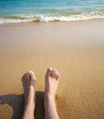 Legs and sand — Stock Photo