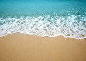 Wave and sand — Stock Photo