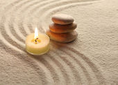 Candle and stone — Stock Photo