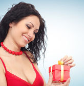 Beautiful woman with gift box — Stock Photo