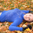 Young happy woman in the autumn park - Stock Photo