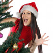 Funny girl near christmas tree — Stockfoto