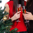 Royalty-Free Stock Photo: Champagne glasses near christmas tree