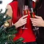 Champagne glasses near christmas tree — Stock Photo