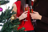 Champagne glasses near christmas tree — Stock Photo